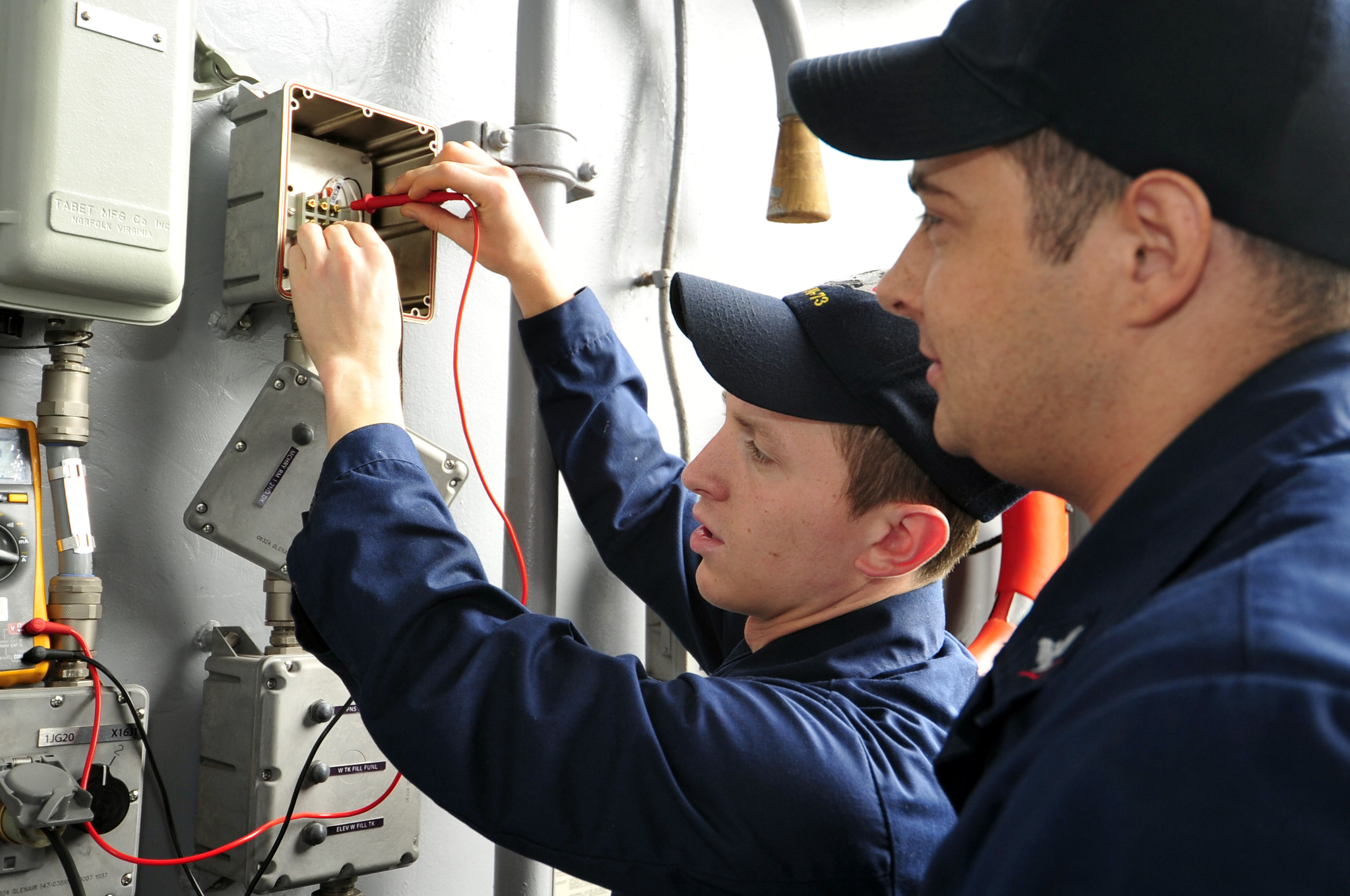 110602-N-VL413-011  YOKOSUKA, Japan (June 2, 2011) Interior Communications Electrician Fireman Michael Colonna, left, from Sterling Heights, Mich., and Interior Communications Electrician 3rd Class Anthony King, from Nacogdoches, Texas, checks for voltage on an aircraft carrier elevator bell buzzer circuit during a dock trial aboard the aircraft carrier USS George Washington (CVN 73). George Washington is the U.S. Navy's only full-time forward-deployed aircraft carrier, homeported in Yokosuka, Japan, and ensures security and stability across the western Pacific Ocean. (U.S. Navy photo by Mass Communication Specialist Seaman Cheng S. Yang/Released)